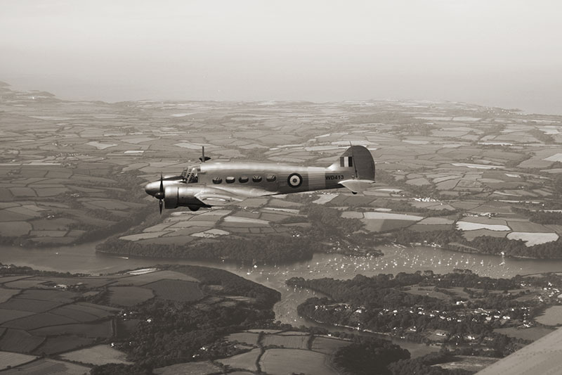 Anson over Cornwall. Image available from Simon Westwood of Fly-by-Light Photography.