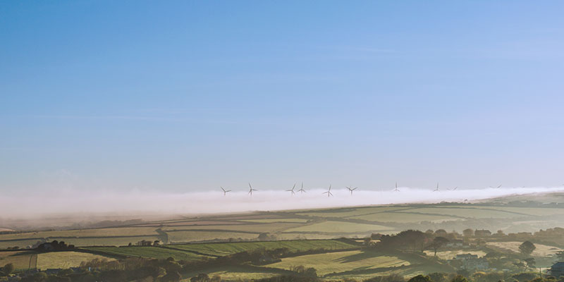 Wind Turbines in the early morning mist - Cornwall. Image available from Simon Westwood of Fly-by-Light Photography.